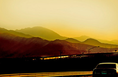 Sunset Blvd. - As the sun sets a lonesome train snakes across the desert near Palm Springs.