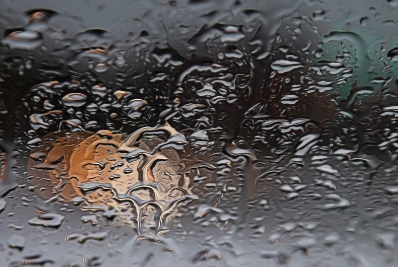 Rain through a windshield creates distortion and refraction.