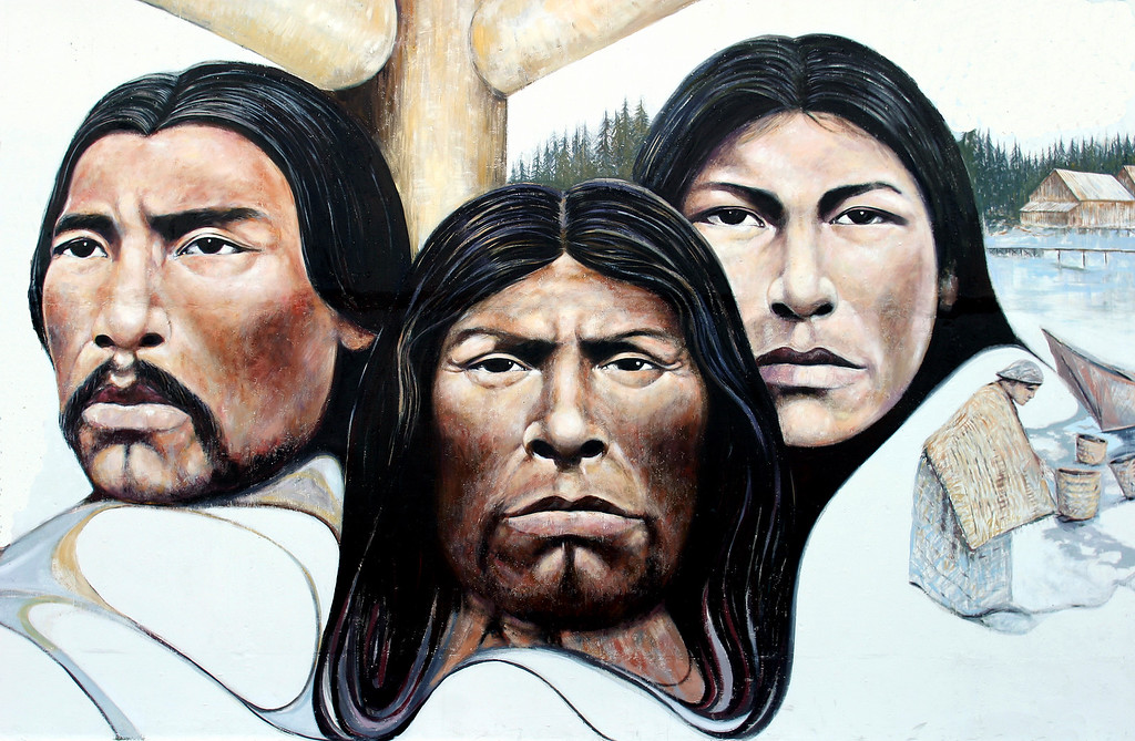 First Nations people adorn the side of a building in Chemainus BC