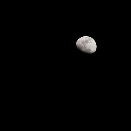 "First time shooting at the Moon in a proper way: APS-C sensor paired with the 70-200mm f/4 Sony FE lens. The formula I was given didn't work for me: 100th f/16 ISO 100; I ended with a better exposure shooting at 1/10th f/22 ISO 100. And I cropped the image to a 10"" x 10"" @ 300ppi for a result I was happy with, due that surrounding clouds had moved away by the time I got it."