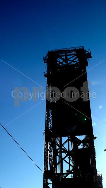 Bridgetown Portland<br /> Vivid blue sky and the black steel railroad bridge crossing the Wilamette in Portland Oregon