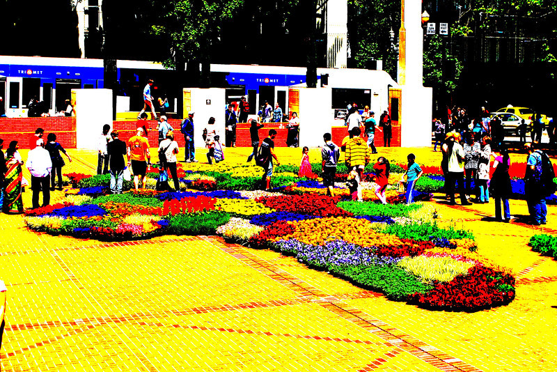 In Pioneer Sq they designed the world using flowers as the countries. Here Africa is shown as the Portland Transit makes a stop.
