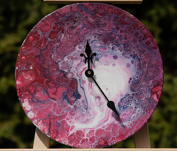 $90. Clock made from acrylic pour on old LP.