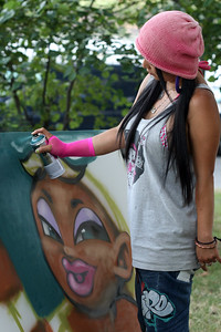 "Aerasol artist at work in Astoria Park during ""The Astoria Music & Arts Festival 2010"""