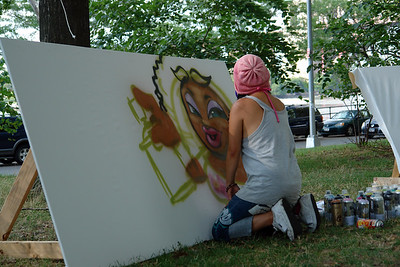 "Aerasol artist at work in Astoria Park during ""The Astoria Music & Arts Festival 2010"""