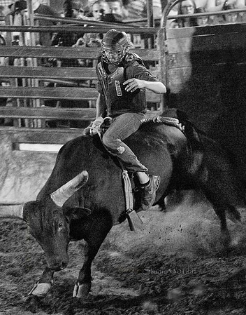 Bull rider rocks flying B&W 3511