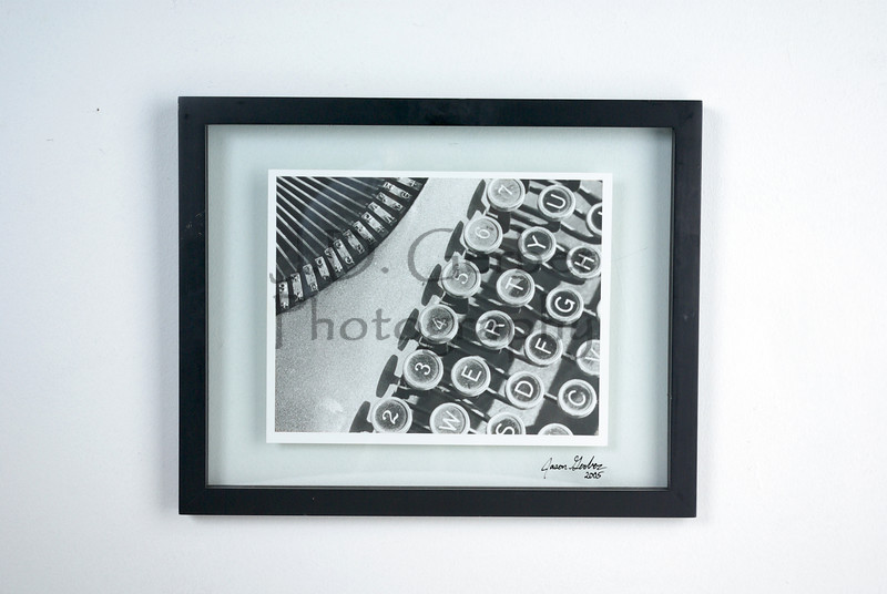 """Click-Click-Ding""<br /> <br /> 8"" X 10"" Hand Printed Black & White Film Photograph.<br /> 11"" X 14"" Glass Trap Frame<br /> <br /> ""This was from the WWII era.  Still has the dusty finger prints on the keys""- JDG"