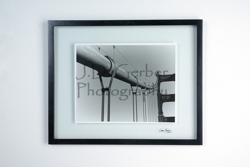 """Support""<br /> <br /> 11"" X 14"" Hand Printed Black & White Film Photograph.<br /> 16"" X 20"" Glass Trap Frame<br /> <br /> ""Golden Gate Bridge.  Made some people anxious as I was climbing over the railing!""-  JDG"