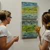 Marie Domer and Cat Lane observe artwork at Gallery Sitka during the opening on Friday morning. SENTINEL & ENTERPRISE / Ashley Green