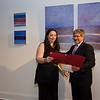 Tamar Russell Brown receives a citation from Mayor Stephen DiNatale during the opening of Gallery Sitka at 454 Main Street in Fitchburg on Friday morning. SENTINEL & ENTERPRISE / Ashley Green