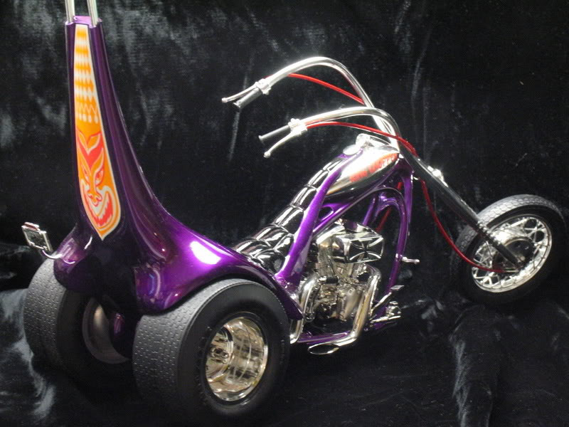 "One of the rarest Tom Daniel trike kits, the ""King Chopper"" is 1/8 scale.  This was the last model kit I owned as I grew up and outgrew models for a while as a teenager.  My original build as a kid sat on the nightstand next to my bed for many years.  When I acquired this kit from old friend John Greczula of Retro Hobbies, I was on cloud 9! It was top of my Grail List for many years.  I wanted to make it a really nice build.  Lot's of sanding and smoothing and a flawless paint job in Kandy Purple."