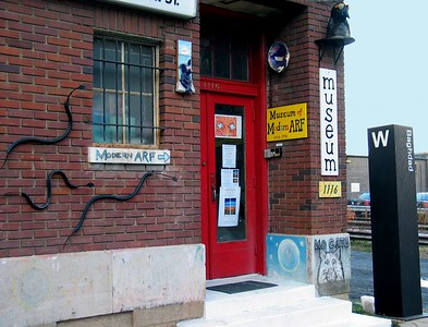 "Museum of Modern ARF, 1116 N. Hudson St., Arlington, VA with Fishburne's ""Snakes"" and Cutler's ""Baghdad Metro Stop,"" HAND PICKED exhbition, December, 2004"
