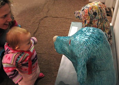 "Young collector Annabelle talks to ""Water Dog"" as artist mom Lola looks on..."