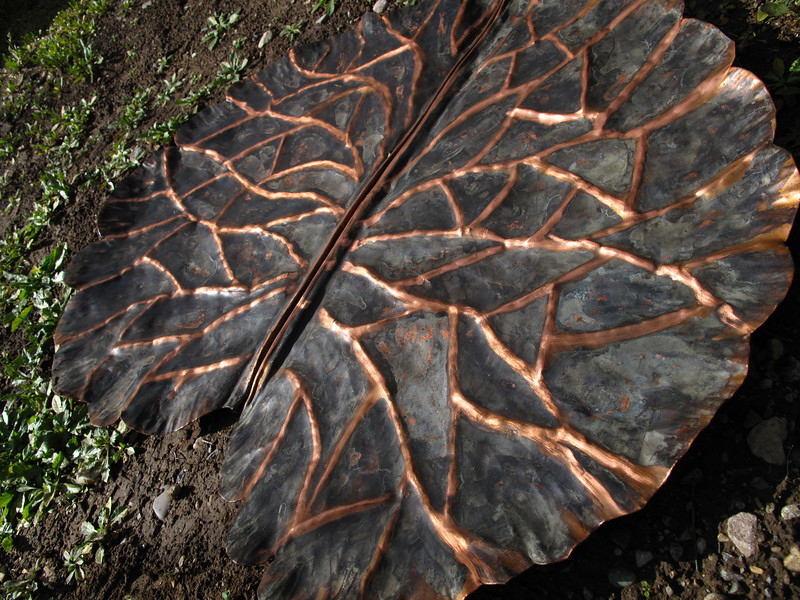 the bottom of this Lily Pad Leaf made of copper has patina to enhance under water darkness