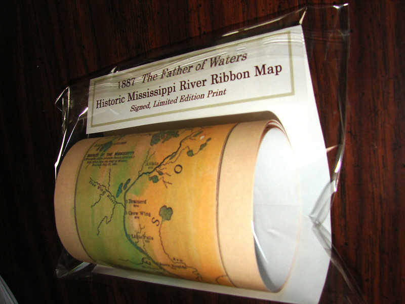 "Our 1887 Glazier Ribbon Map of the full length of the Mississippi River as packaged for retail sale. This historic map reproduction has been hand-painted by map artist, Lisa Middleton, and reproduced as a quality ""limited edition"" gift print. The first edition had 1000 copies. The 2nd edition had 2,000 copies. Each print is signed, dated with the release date, and numbered.<br /> <br /> FATHER OF WATERS<br /> 4x40""    $21.95<br /> <br /> Great gift for river buffs or map collectors in your family.  <br /> 888-255-7726"
