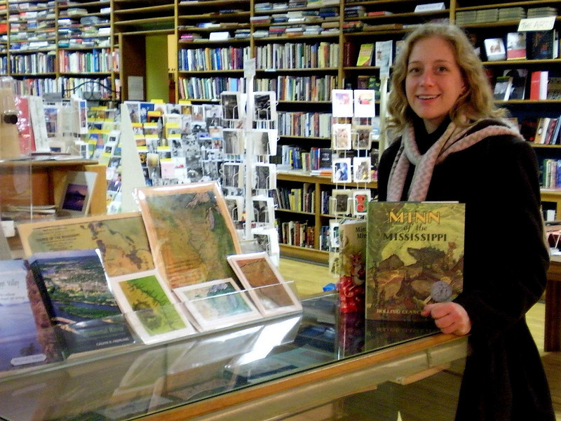 Map artist, Lisa Middleton, with maps displayed at Pearl Street Books.<br /> <br /> Yes, we will paint reproductions of your favorite personally owned map! Please phone 888-255-7726 to inquire.
