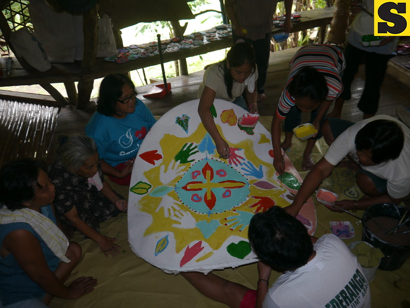 CAGAYAN DE ORO. This mandala making is helping the community heal from the flash flood that struck Barangay Hubangon in Mahinog town in Camiguin on 2001. (Maria Rosalie Zerrudo)