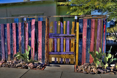 A vividly colorful wooden fence in Tucson, Arizona