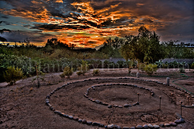 An amazing, dramatic, and colorful sunset above a back yard with a circle garden in Tucson, Arizona.