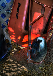 A red wheel barrel appears to spill out the Tucson morning light