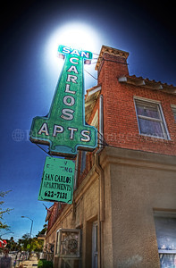 A mystical sun blazed above the San Carlos Apartments sign in Tucson, Arizona.