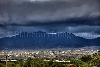Ominous storm clouds over Tucson and Mountains.