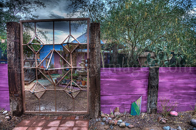 This exotic gate and wall encloses a backyard near Downtown Tucson, Arizona