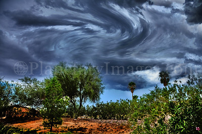 Twirling storm clouds over Tucson landscape