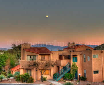 The moon rises over a Tucson apartment complex.