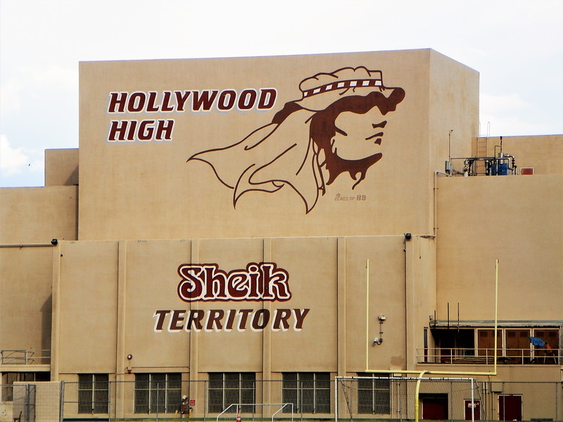 """The school's mascot is """"The Sheiks"""" which was inspired by the pictured Rudolph Valentino 1921 movie of the same name."""