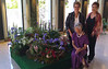 Amy Lee (seated), with Patsy Ransom (standing left, past president of National Presbyterian Church Flower Minsitry), and Beverly Tam (standing right), chief designer of this arrangement)