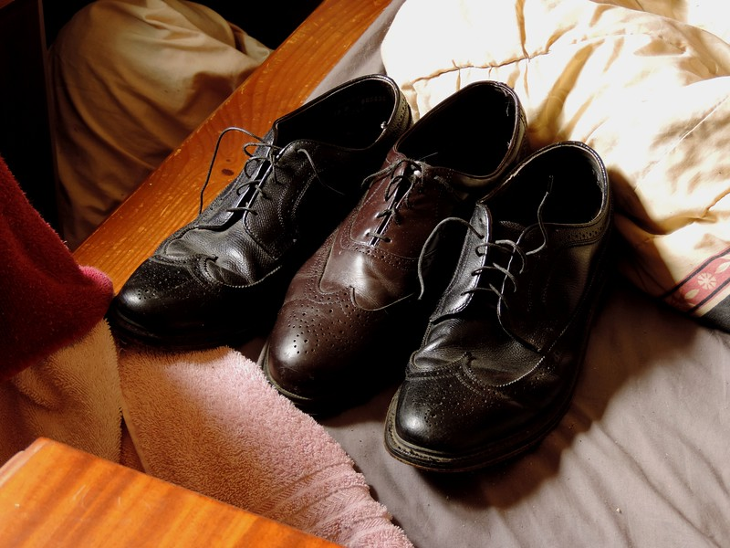 Thanksgiving morning 2016.  My shoes on the end of the bed.  Made me think of by brother Joe, who loves wingtips, and my daughter Alisha who always notices oddities.  I really like the tones & composition of this shot also.