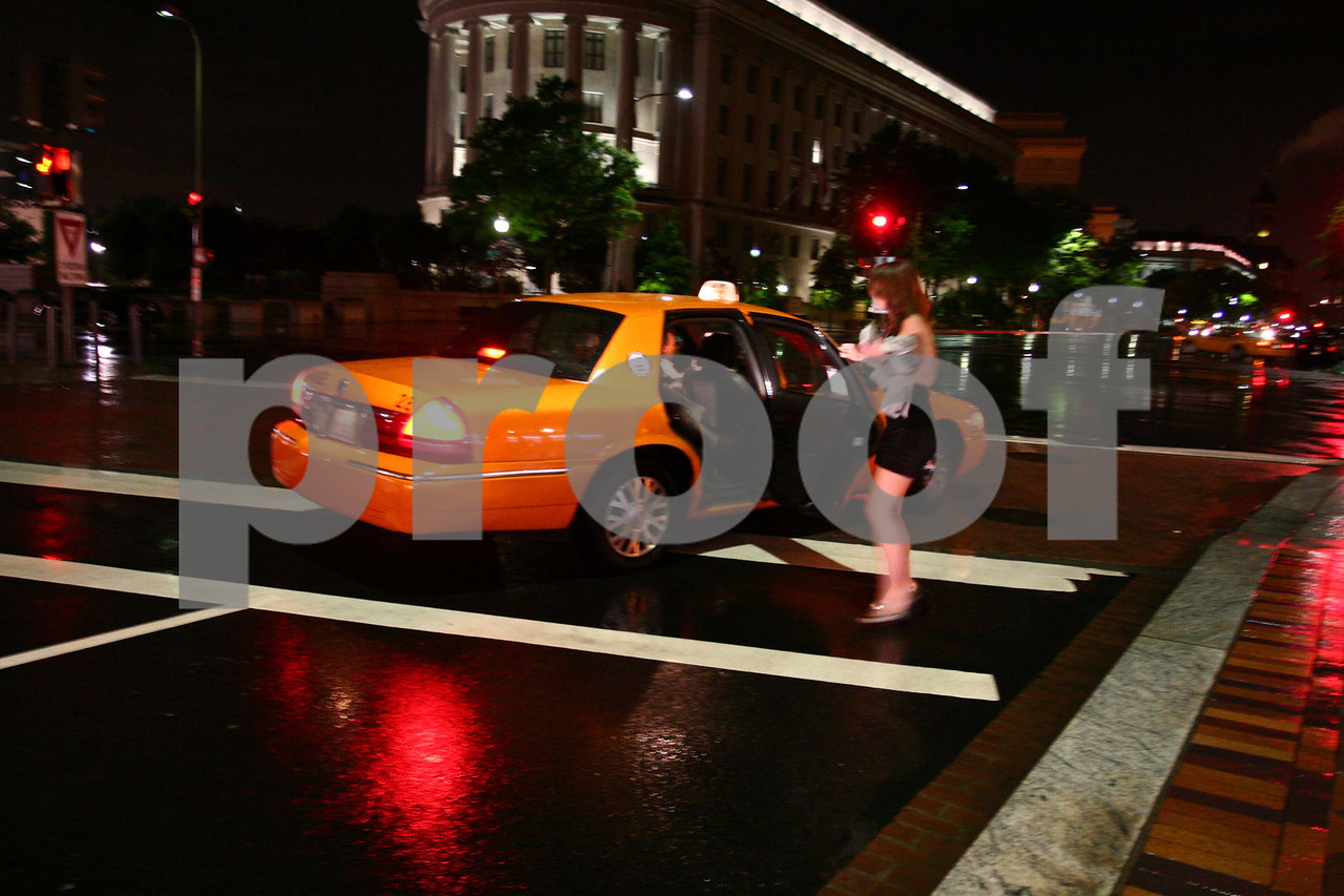A taxi cab makes a stop in WA DC.