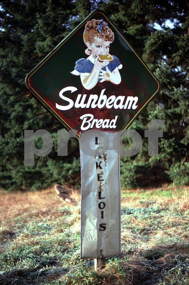 A very old and very rare sign advertising Sunbeam Bread greets people entering Lois Lake located on the eastern edge of Lacey, WA on January 1, 1976.