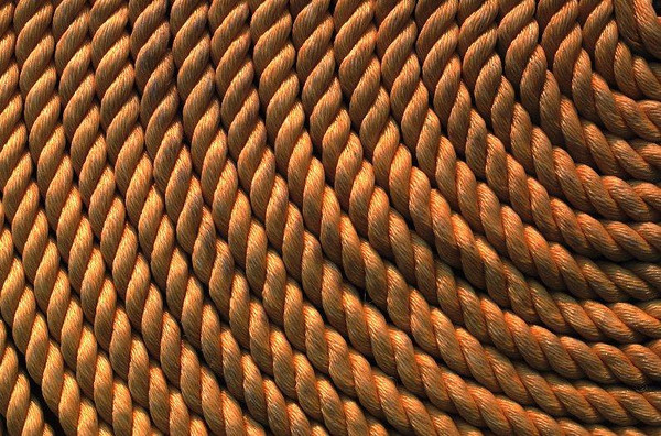 Coiled line sets on the deck of a ship.