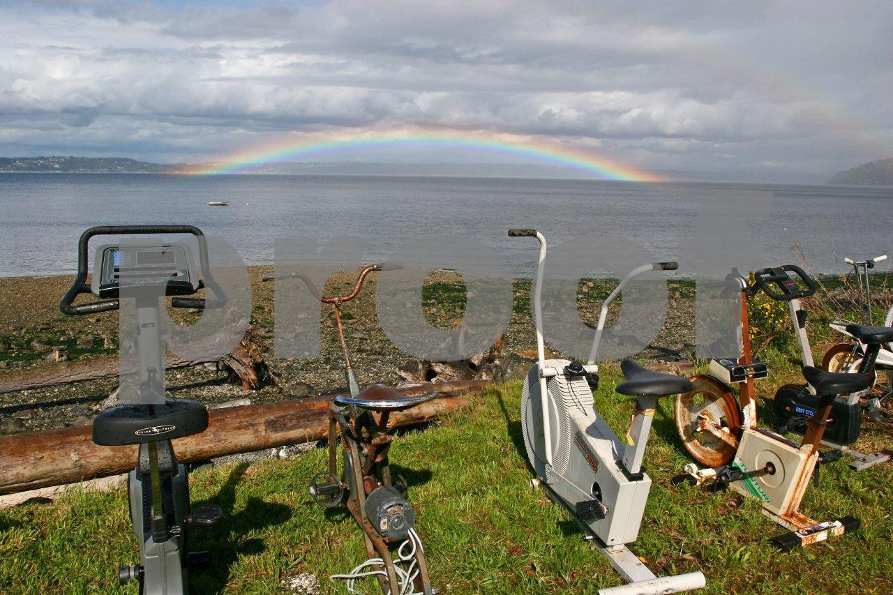 A rainbow arches over a collection of excercise machines that promise to some the goal of weight loss.