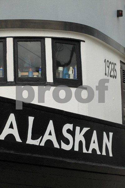 "A fishing boat named ""Alaskan"" awaits the start of salmon fishing season."