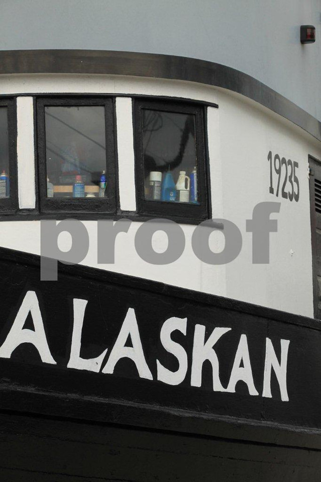 "A fishing boat named ""Alaskan"" awaits the start of salmon fishing season."