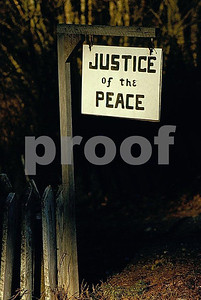 A Justice of the Peace sign hangs in bnneville, WA prior to when the whole town was moved and renamed North Bonneville because of the expansion of the Bonneville Dam on the Columbia River between OR and WA.