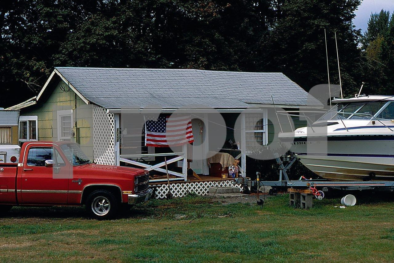 A home complete with motorhome, pick up truck, boat, bbq and the American flag, this is the American Dream.
