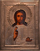 Cleaned and repaired icon of the Christ Pantocrator.  Left side is the cleaned side. Halo had come off and was reinstalled.