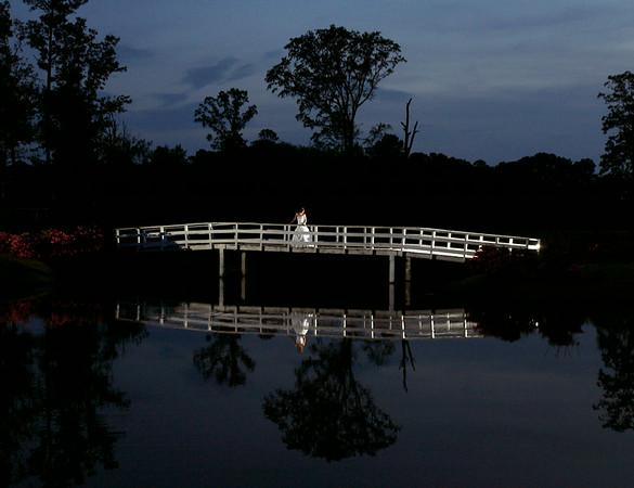 A bridal portrait on a bridge, lit with remote strobes.