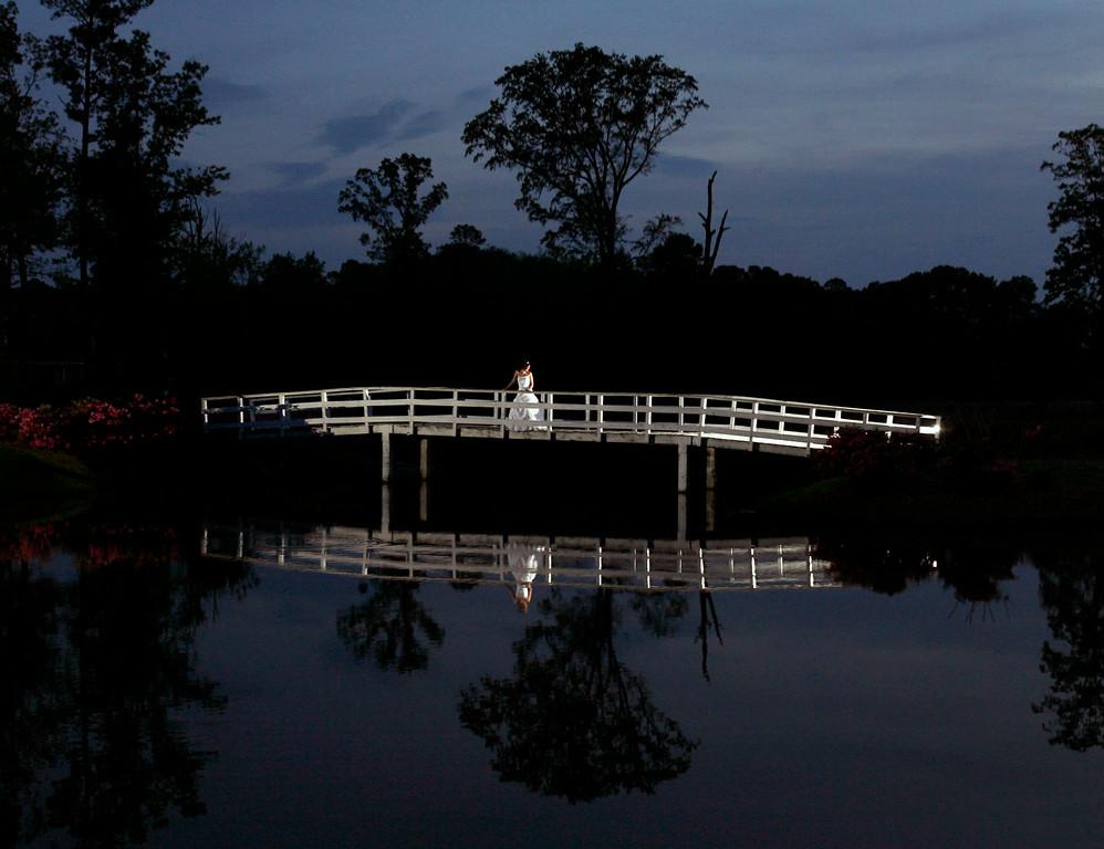 A bridal portrait on a bridge, lit with remote strobes.