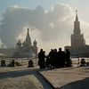 A group of Russian tourists gather on the edge of Red Square in the frozen Russian winter with snow and ice on the ground as a large steam cloud rises from the National Hotel behind St. Basil's Church and the Kremlin.  (Jenni Farrow)