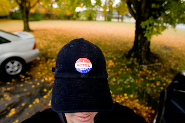 "Pausing for a quick self-portrait,after photographing all ages and races of local voters, I couldn't resist the fall foliage in the background at the American Legion site on St. Andrews Drive.  As I snapped my own ""I Voted"" sticker, a woman in the silver car shouted out to a passer-by ""Did you vote today?  We could make history today!""."