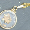 A locket I put together for my wife, some gold from East Fork, and some gold from Alaska. She liked it I think.