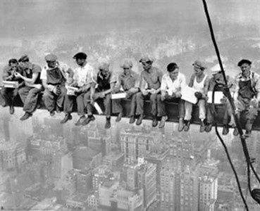 Lunch atop a Skyscraper (New York Construction Workers Lunching on a Crossbeam) is a famous photograph taken by Charles C. Ebbets during construction of the GE Building at Rockefeller Center in 1932.  The photograph depicts 11 men eating lunch, seated on a girder with their feet dangling hundreds of feet above the New York City streets. Ebbets took the photo on September 29, 1932, and it appeared in the New York Herald Tribune in its Sunday photo supplement on October 2. Taken on the 69th floor of the GE Building during the last several months of construction, the photo Resting on a Girder shows the same workers napping on the beam.