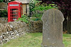 Grave and phone booth England