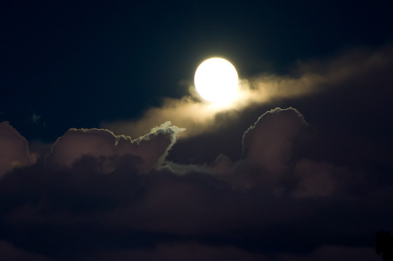 Full moon coming through the clouds