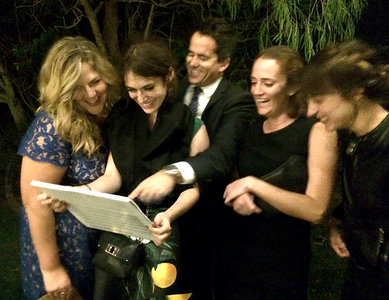 actress Lizzy Kaplan and friends reacting to their group caricature drawn by artist James Malia at one Wonderful wedding at  the Awesome Graf Barn in Oxnard, CA